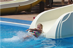 Girl coming off the slide into the water